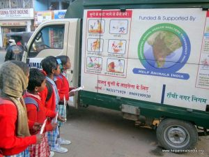 Children looking at Help Animals India sign (Courtesy of Help Animals India)