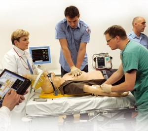 The human-body simulator (like the one at University of Washington) being used for training. (Photo courtesy of Laerdal Medical)